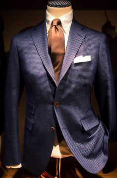 bronze tie + blue jacket with ticket pocket