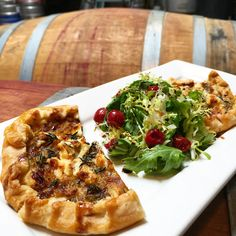 At Brooklyn Winery's Williamsburg wine bar, we bring savory eats and fine wine together for an epic Brooklyn experience.  Pictured here is our Braised Leek & Goat Cheese Tart highlighted with roasted grapes and balsamic glaze.