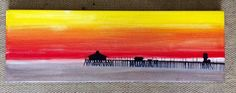 """Original """"HB Pier"""" acrylic painting. Huntington Beach's iconic sunset and pier. Summer nights all start this way in Southern California. By ArtRoom278. Easy to hang. Size 24 x 8"""