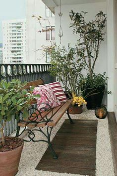 Pebble floor and a garden bench on a balcony.