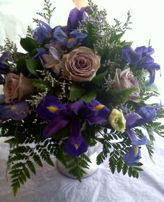 Fantasy Flowers & More ~ Amnesia Rose and Iris centerpiece. www.fantasyflowersandmore.com