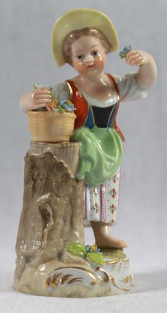 ANTIQUE MEISSEN PORCELAIN FIGURE OF A GIRL SELECTING FLOWER SPRAYS FROM BASKET