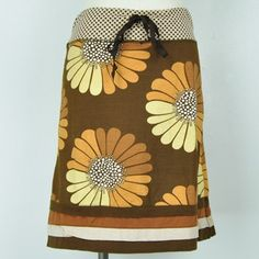 Sunflower Sol Skirt, Spread sunshine and smiles wherever you go with the cheerful & chic style of our Sunflower Sol Skirt. Made from a soft and sturdy 100% cotton jersey, this sweet a-line skirt features bold illustrations of marvelously mod flowers, accented by contrasting trim at the waist and hem. $34