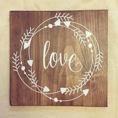Love Wood sign. Wooden sign with Love in white matte professional grade vinyl. Measures approx. 12 x 12. Sawtooth hook on back for easy wall hanging of would like great as an accent on a shelf too! This sign is cut, sanded and made of wood which means your item may have visible knots,