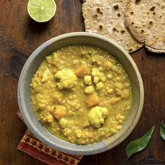 This southern-Indian-inspired vegetable dal recipe is rich and creamy thanks to light coconut milk and gets exotic flavor from spice-infused coconut oil. Serve with flatbread or naan.