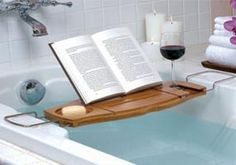 Awesome! Caddy for book, drink, iPad, what-ev while soaking in a bath. Want.
