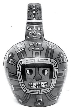 27/ HUARI - Bottle, Deity Face. Wari, Peru, 6th-8th century. MET. Influence Nasca bien visible avec les couleurs, l'absence d'incisions et les traits noirs. Yeux blancs et noirs = Wari. http://www.museolarco.org/wp-content/uploads/2013/08/Silbadora-Fardo-Huari.pdf