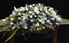 Blue & white casket spray. #sympathyflowers #floraltribute  F04