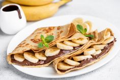 Crepes stuffed with chocolate spread and banana on white plate. Chocolate Crepes, Chocolate Spread, Banana Crepes, Thin Pancakes, Coffee Images, Sweet Desserts, Nutella, Waffles, Cake Recipes