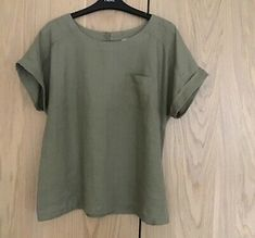 M&S Collection olive linen top size Condition is Used. Turn ups on sleeves. 2 button opening at the back. Olive Shorts, Pink Sequin, Tunic Blouse, Cashmere, Size 12, Breast, Pocket, Summer Dresses, Button