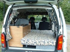 Minivan to camper conversion. This photo is from a UK Small Van Campervan Conversion Project website. http://www.campervanconversion.co.uk/projects/small-van/tin-tent-2