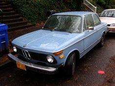 OLD PARKED CARS.: 1976 BMW 2002.
