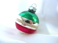 This vintage, small striped Shiny Brite Christmas ornament will add some nostalgia and sparkle to your Christmas decor! It has a silver base