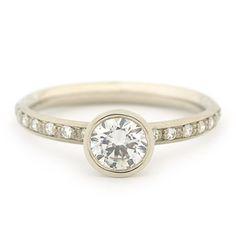Bezel set diamond solitare ring by Anne Sportun.