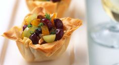 This quick-to-fix snack is sure to be a hit! Sweet grapes, dried apricots, almonds and Brie provide a delicious, sweet and savory filling for prepared phyllo cups.