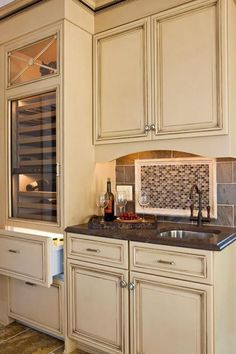 Traditional Home Showhouse in Maryland -Prep area with tile backsplash, Herbeau Valence faucet and Seine oval bowl