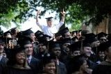 A student cheers during the University of Mississippi commencement ceremony in Oxford, Miss., Saturday, May 10, 2014. (AP Photo/The Daily Mississippian, Thomas Graning)