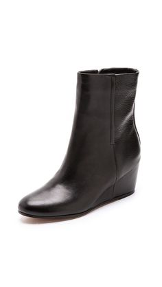 Vince // Michela Wedge Booties // $495.00 // I know these are over price range but I think they're reaaaaaally classy and also suit your style. // TOP CHOICE