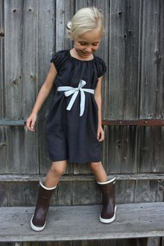 Love ribbon belts on little girl's dresses. Put your own ribbon on a drab dress to embellish it.