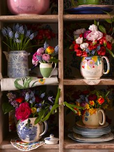 flowers in jugs. From Vintage Flowers - Choosing, arranging, displaying by Vic Brotherson of Scarlet & Violet. Shot by Catherine Gratwicke.