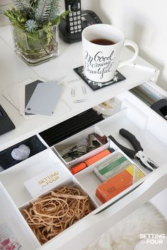 Desk organization tip: use premade desk drawer organizers. I picked up this IKEA KUGGIS desk organizer to compartmentalize my large desk drawers. Love how much stuff it stores and organizes! See this and all of my easy desk organization tips at www.settingforfour.com