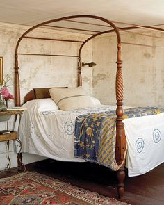 A canopy bed in a guest room is covered with a vintage Indian sari.