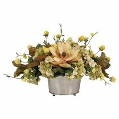 """Bring garden-fresh style to your home with this lovely faux hydrangea and magnolia arrangement, displayed in a metal planter.   Product: Faux floral arrangementConstruction Material: Silk, plastic and metalColor: Cream and brownDimensions: 20.5"""" H x 29"""" W x 21"""" D Note: For indoor use only"""
