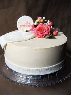"""Lemon cake filled with lemon curd and fresh raspberries makes a perfect wedding cake! The cake was adorned with a dusty rose and coral gum paste roses, and a lace fondant """"fabric"""". #weddingcake #gumpasteroses #embossedfondant"""