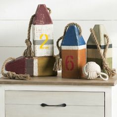 Decorative Painted Wood Buoys: http://www.completely-coastal.com/2010/06/painted-wooden-lobster-buoys-for-decor.html