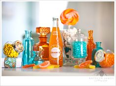 i love this picture! i love orange soda! and i love all the colorful bottles!