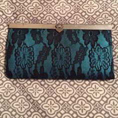 "Blue lace wallet Used with love. In good condition.     No trades. ❌ ""Lowest?"" ❌ REASONABLE offers. ✅ Only deal with offers through the offer button.  NO drama. ❌ Rude comments will be blocked. ❌ Rue 21 Bags Wallets"