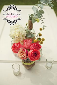 Hydrangea and coral rose centerpiece in burlap wrapped vase with brooch.  On top of vintage door tabletop.  Summer shabby chic barn wedding. Photography by Andie Freeman Photography www.TheAthensWeddingPhotographer.com Event design, floral, and planning by Wildflower Event Services www.WildflowerEventServices.com Venue:  Private property in Chickamauga, Ga Flower Decorations, Table Decorations, Barn Wedding Inspiration, Rose Centerpieces, Event Services, Event Design, Wedding Details, Summer Wedding, Wild Flowers