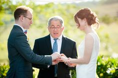 Exchanging Rings at a Bluegrass Barn Wedding at Riverside on the Potomac in Leesburg VA | Kelly Ewell Photography
