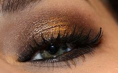smokey, gold eye makeup