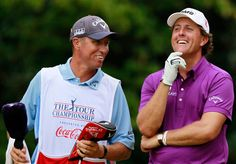 Phil Mickelson (R) talks with caddie Jim 'Bones' Mackay ...