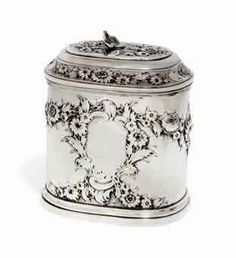 Vintage George II Silver Tea Caddy MARK OF JOHN NEWTON, LONDON, 1743 Rounded rectangular with pull-off cover, chased with trailing flowers and vacant cartouche to either side.