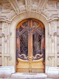 fabulous arched French Art Nouveau door in Paris