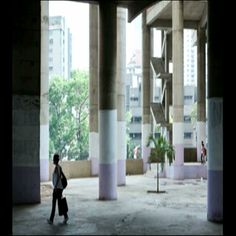Caracas Venezuela - Entrance to the 45 story structure. The residents have painted the lobby and have planted trees.