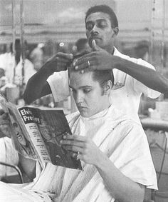 Just getting a haircut and reading about himself.