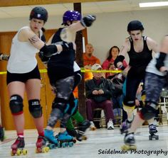 INTENSITY!  Flesner jams for the Cape Girardeau Roller Girls during our season opener mashup bout February 2014!  Shantastic Vixen prepares to block for the white team while Nomnivore from the Clarksvillians shows off some backwards blocking to make a hole for her jammer!