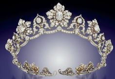 DIAMOND TIARA of 9 old-cut diamond graduating flowerhead clusters centred by old-cut pear & cushion shape diamond collet highlights, the central principal very light pink diamond interspersed by ten similarly-set stylised cusp motifs of ribbon scroll design, raised on an undulating diamond line frame, mounted in silver and gold, circa 1850, each flowerhead cluster detachable to form a brooch.  Originally owned by the Marchioness of Conyngham.  Image Christies.  See also off-the-frame board.