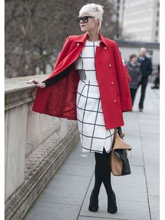 red with black & white is always a good idea.......On the streets during London Fashion Week. Photo by Karl-Edwin Guerre.