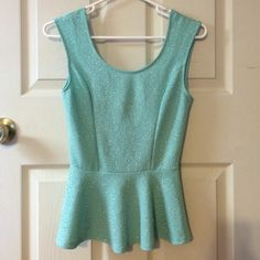 Teal peplum new! Teal peplum ! New never worn! Has black bow in the back. Very cute top and perfect for spring ! Tops