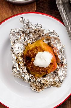 Cooking this homey dessert in your campfire is as simple as moving the low-burning logs out into a frame to create a bed of embers in the center. Whipped crème fraîche gives it a touch of sophistication.#camping #campingrecipes #campfire #campfirecooking #campfirerecipes Campfire Desserts, Campfire Food, No Cook Desserts, Summer Desserts, Easy Desserts, Delicious Desserts, Dessert Recipes, Yummy Food, Campfire Recipes