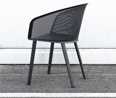 Like a knight's chain-mail hood, Kettal's cupped aluminum Stampa chair appears both fluid and sturdy.