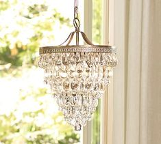 downstairs bedroom-  This will add some bling and drama, without over-powering the room. Also works well in blending contemporary and traditional. Clarissa Glass Drop Small Round Chandelier