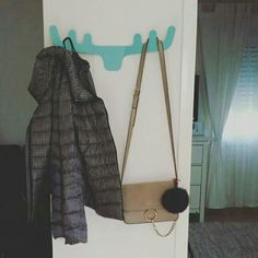 Our designed coat rack on Orna's wall :)