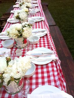 Love this red and white table cloth with the tomato cans as vases! Such a cute idea to coy at my barn wedding in San Diego at Red Barn Farm Weddings