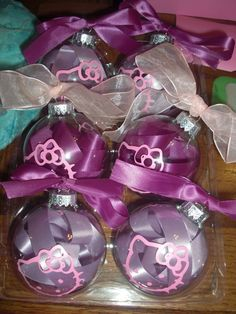 I used the Cricut Hello Kitty cartridge, glass ornaments, and some old ribbon to make these. Christmas Craft Fair, Christmas Vinyl, Purple Christmas, Christmas Heaven, Holiday Crafts, Hello Kitty Crafts, Hello Kitty Themes, Hello Kitty Christmas Tree, Diy Christmas Ornaments