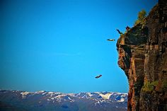 BASE jumpers hurl themselves headfirst off a cliff almost a mile high -Norway